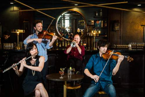 Chris Detrick  |  The Salt Lake Tribune Utah Symphony musicians Mercedes Smith, Joel Gibbs,  Jeff Luke and Hugh Palmer pose for a portrait at Finca in Salt Lake City, where they and colleagues will perform in a MOTUS After Dark event on Saturday, May 14.