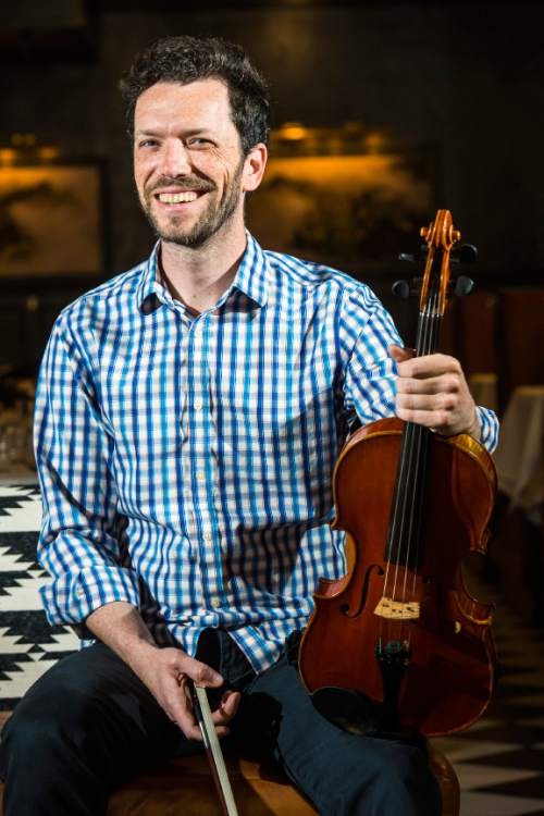 Chris Detrick  |  The Salt Lake Tribune Utah Symphony violist Joel Gibbs poses for a portrait at Finca in Salt Lake City, where he and some colleagues will perform in a MOTUS After Dark event on Saturday, May 14.