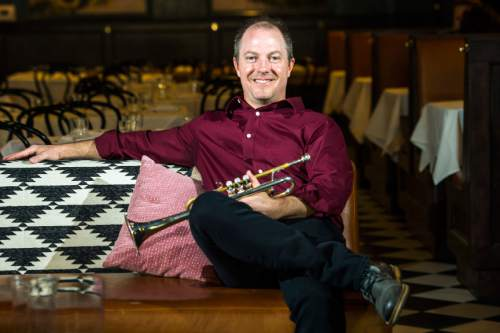Chris Detrick  |  The Salt Lake Tribune Utah Symphony Associate Principal Trumpet Jeff Luke poses for a portrait at Finca on Wednesday, May 4, 2016. Luke is among the orchestra musicians who will play short chamber works, including one he composed for an impromptu performance on Wall Street, during a MOTUS After Dark event at Finca on Saturday, May 14.
