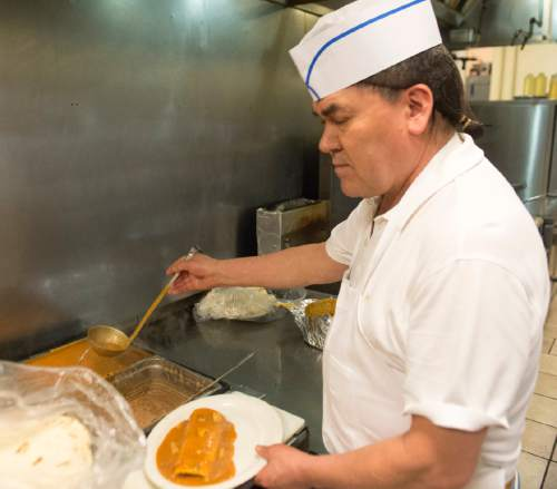 Rick Egan  |  The Salt Lake Tribune  Luis Lopez makes a smothered burrito, at the La Puente restaurant on State Street, Friday, April 29, 2016.