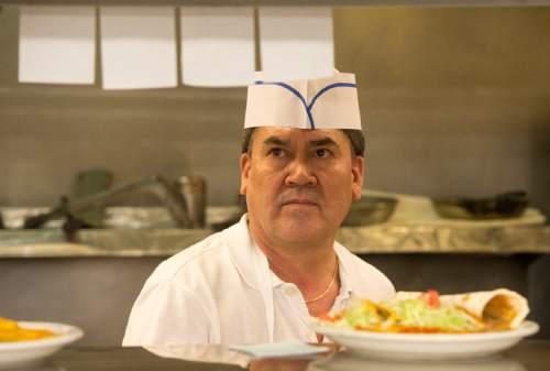 Rick Egan  |  The Salt Lake Tribune  Luis Lopez cooks at the La Puente restaurant on State Street, Friday, April 29, 2016.