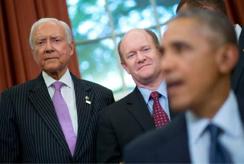 Sen. Orrin Hatch, R-Utah, left, and Sen. Chris Coons, D-Del., center, listen as President Barack Obama speaks in the Oval Office of the White House in Washington, Wednesday, May 11, 2016, before signing the Defend Trade Secrets Act of 2016 (DTSA). Coons and Hatch cosponsored the bill that would establish a Federal civil private cause of action for trade secret theft that would provide businesses with a more uniform, reliable, and predictable way to protect their valuable trade secrets anywhere in the country. (AP Photo/Pablo Martinez Monsivais)