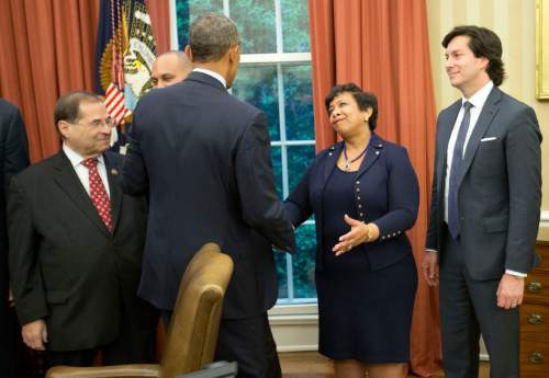 President Barack Obama, center, greets from l-r, Rep. Jerrold Nadler, D-NY., Rep. Hakeem Jeffries, D-NY., Attorney General Loretta Lynch, and U.S. Intellectual Property Enforcement Coordinator Danny Marti, after signing the Defend Trade Secrets Act of 2016 (DTSA), in the Oval Office of the White House in Washington, Wednesday, May 11, 2016. The Act would establish a Federal civil private cause of action for trade secret theft that would provide businesses with a more uniform, reliable, and predictable way to protect their valuable trade secrets anywhere in the country. (AP Photo/Pablo Martinez Monsivais)