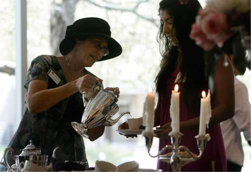 Scott Sommerdorf   |  The Salt Lake Tribune  Debi Levin-Stankevich, left, pours tea for Alexia Martinez at the annual Silver Tea in 2013.