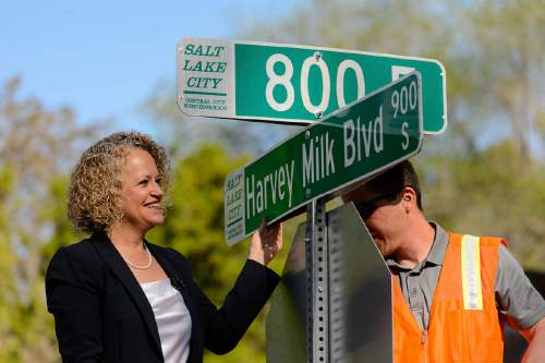 Trent Nelson  |  The Salt Lake Tribune Mayor Jackie Biskupski and sign shop supervisor James Aguilar hang the first of the Harvey Milk Blvd. street signs along 900 South in Salt Lake City, Friday May 13, 2016. The Salt Lake City Streets Division will hang signs throughout the day between 800 East and 1100 East in preparation for the Harvey Milk Celebration on Saturday, May 14th. Signage along the remaining designated portions of 900 South will be completed in the next few weeks.