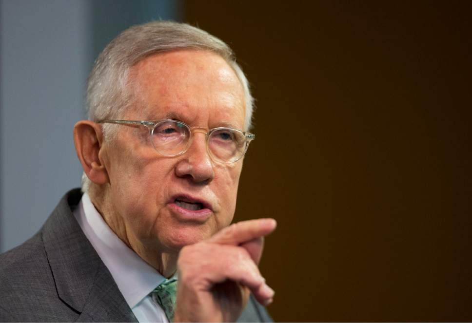 """Senate Minority Leader Harry Reid, D-Nev.,  gives a speech at Center for American Progress Action Fund, in Washington, Thursday, March 17, 2016, discussing """"how years of vitriolic Republican rhetoric - and the party's refusal to engage thoughtfully in any policy area - led to the rise of GOP presidential front-runner Donald Trump."""" (AP Photo/Manuel Balce Ceneta)"""