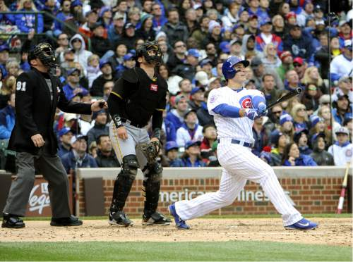 Chicago Cubs' Anthony Rizzo (44) watches his three-run home run against the Pittsburgh Pirates during the fourth inning of a baseball game, Saturday, May 14, 2016, in Chicago. (AP Photo/David Banks)