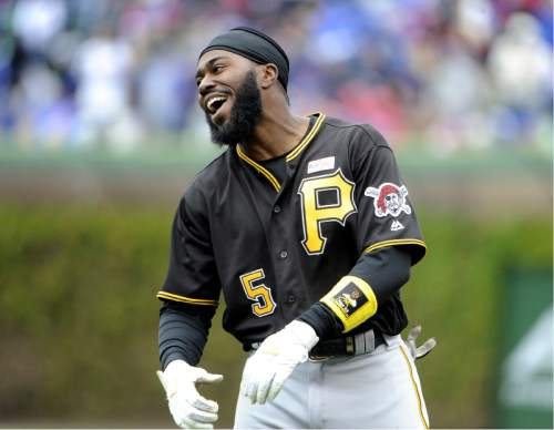 Pittsburgh Pirates' Josh Harrison (5) reacts after hitting into a double play against the Chicago Cubs during the fourth inning of a baseball game, Saturday, May 14, 2016, in Chicago. (AP Photo/David Banks)