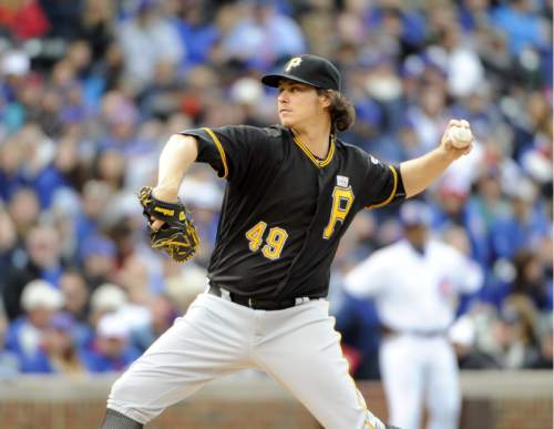 Pittsburgh Pirates starting pitcher Jeff Locke (49) throws against the Chicago Cubs during the first inning of a baseball game, Saturday, May 14, 2016, in Chicago. (AP Photo/David Banks)