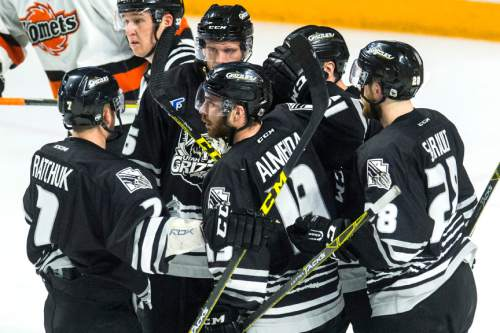 Chris Detrick  |  The Salt Lake Tribune Grizzlies' Ryan Hayes (91) celebrates with his teammates after scoring a goal during Game 4 of the ECHL playoff series at Maverik Center Friday May 6, 2016.