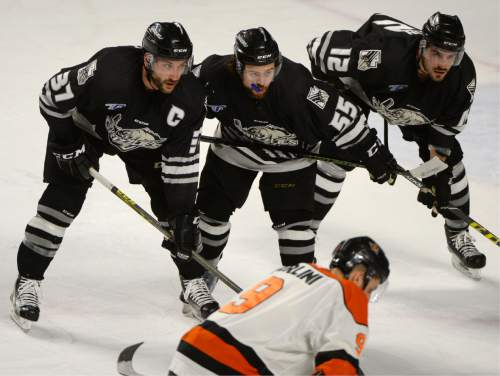 Steve Griffin / The Salt Lake Tribune  The Utah Grizzlies form a wall during a face off during the Utah Grizzlies versus the Fort Wayne Comets at Maverik Center in West Valley CityWednesday May 4, 2016.