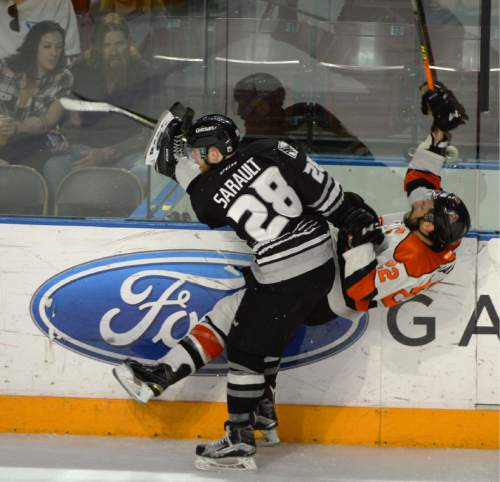 Steve Griffin / The Salt Lake Tribune  Grizzlies' Charles Sarault sends Jamie Schaatsma of Fort Wayne into the air during playoff hockey at Maverik Center in West Valley CityWednesday May 4, 2016. Sarault was called for tripping on the play.