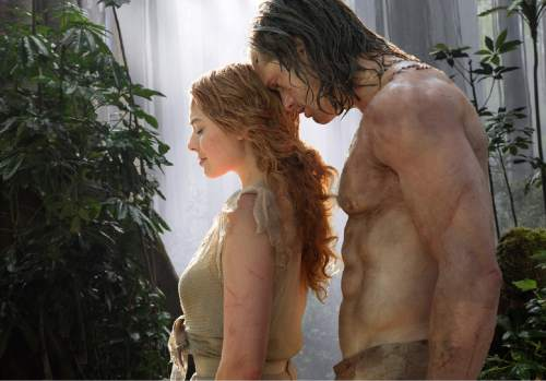 "This image released by Warner Bros. Entertainment shows Margot Robbie as Jane, left, and Alexander Skarsgard as Tarzan in a scene from, ""The Legend of Tarzan."" (Jonathan Olley/Warner Bros. Entertainment via AP)"