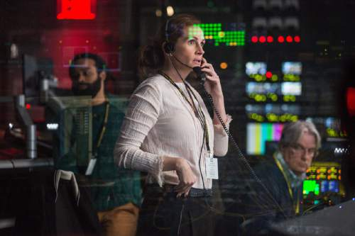 "This image released by Sony Pictures shows Julia Roberts in a scene from ""Money Monster,"" opening in theaters nationwide on May 13. (Atsushi Nishijima/Sony Pictures via AP)"