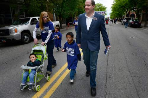 Scott Sommerdorf   |  Tribune file photo Jonathan Swinton, a Democratic Senate candidate, walks with his family in the Midvale Cinco de Mayo parade. He is running as a conservative Democrat.