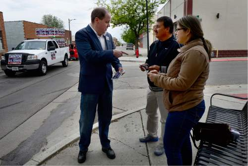 Scott Sommerdorf   |  The Salt Lake Tribune   Jonathan Swinton, a Democratic Senate candidate hands out a campaign card as he walks in the Midvale Cinco de Mayo parade, Saturday, May 7, 2016. Swinton and Misty Snow are the Democratic candidates facing off in the June primary.