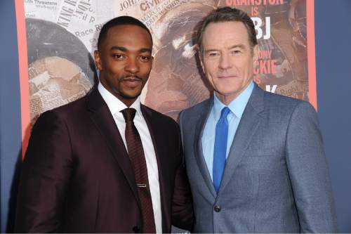 """Bryan Cranston, right, and Anthony Mackie attend the LA Premiere of """"All The Way"""" held at Paramount Pictures Studios on Tuesday, May 10, 2016, in Los Angeles. (Photo by Richard Shotwell/Invision/AP)"""