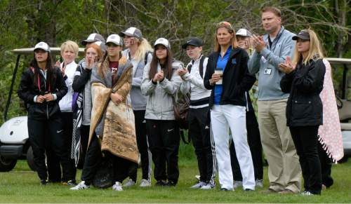 Al Hartmann     The Salt Lake Tribune Crowd wrapped in blankets for stormy weather watch the final threesome tee off  on the final day of the of the 5A girls' golf tournament on the Lake Course at Wasatch Mountain State Park Monday May 17.