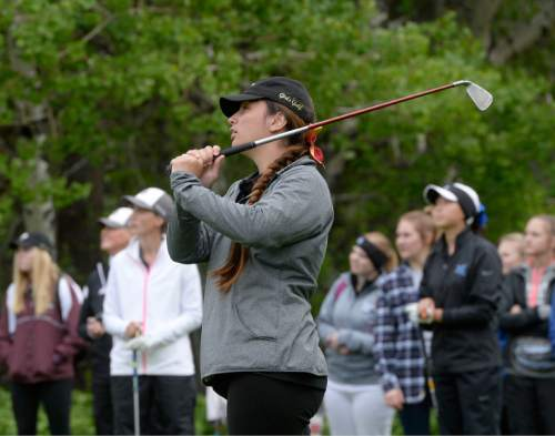 Al Hartmann     The Salt Lake Tribune Lone Peak's Masina Kaohelaulii drives from the first tee on the final day of the of the 5A girls' golf tournament on the Lake Course at Wasatch Mountain State Park Monday May 17.