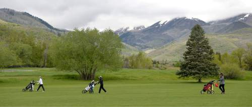 Al Hartmann     The Salt Lake Tribune Top 5A threesome, Davis High School's Laura Gerner, left, Binham's Tess Blair and Lone Peak's Masina Kaohelaulii wlak the front nine on the stormy final day of the of the 5A girls' golf tournament on the Lake Course at Wasatch Mountain State Park Monday May 17.