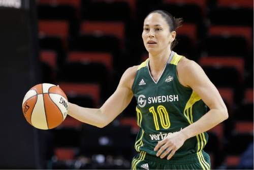 This May 4, 2016 photo shows Seattle Storm's Sue Bird in action against the Phoenix Mercury in a WNBA preseason basketball game in Seattle. Bird understands a transition is under way. The Seattle Storm are undergoing an evolution. But Bird still remains the American standard for point guards and it's why Bird will be the one to decide when she's ready to walk away from the professional game. (AP Photo/Elaine Thompson)