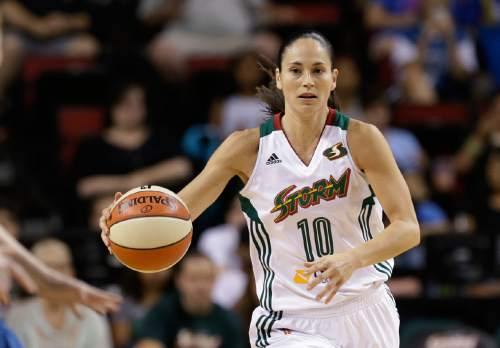 This June 25, 2015 file photo shows Seattle Storm's Sue Bird in action against the Minnesota Lynx in a WNBA basketball game in Seattle. Diana Taurasi, Sue Bird and Tamika Catchings will play in their fourth Olympics, anchoring the U.S. women's basketball team heading to the Rio Games in August. The trio was among 12 players named to the team that was announced Wednesday morning, April 27, 2016, a group that included first-time Olympians Elena Delle Donne, Brittney Griner and Breanna Stewart.  (AP Photo/Elaine Thompson, File)