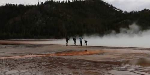 Courtesy Jill Thompson  |  YouTube  Three men have been issued arrest warrants for allegedly trespassing in Yellowstone National Park last week.