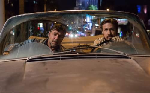 """This image released by Warner Bros. Entertainment shows Ryan Gosling, right, and Russell Crowe in a scene from """"The Nice Guys."""" (Daniel McFadden/Warner Bros. Entertainment via AP)"""
