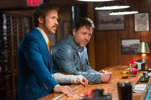 """This image released by Warner Bros. Entertainment shows Ryan Gosling, left, and Russell Crowe in a scene from """"The Nice Guys."""" (Daniel McFadden/Warner Bros. Entertainment via AP)"""