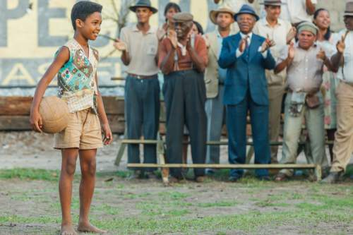 "Leonardo Lima Carvalho plays the soccer legend PelÈ as a 10-year-old boy, in the sports biography ""PelÈ: Birth of a Legend."" Ique Esteves  