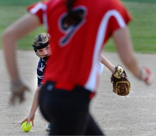 Steve Griffin / The Salt Lake Tribune  Tooele second basemen Makenna Baker eyes first as she picks up the ball as Bear River's Mckenzi Summers charges down the line to first base during Class 3A softball quarterfinal game against Bear River at the Valley Softball Complex in Taylorsville, Utah Thursday May 19, 2016.