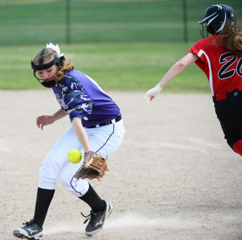Steve Griffin / The Salt Lake Tribune  Bear River base runner Keagan Summers is called out fro running out of the baseline as Tooele second basemen Makenna Baker knocks down a ground ball during Class 3A softball quarterfinal game against Bear River at the Valley Softball Complex in Taylorsville, Utah Thursday May 19, 2016.