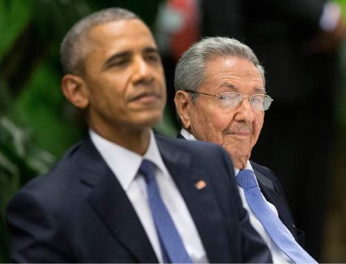 FILE - In this March 21, 2016 file photo, U.S. President Barack Obama, left, attends a State Dinner hosted by Cuban President Raul Castro at the Palace of the Revolution in Havana, Cuba. Chanel, Carnival, and 'Fast and Furious': A triple tsunami of global capitalism that pounded Havana in May ignited a fierce debate among Cuban intellectuals about the downside of detente with the United States. (AP Photo/Pablo Martinez Monsivais, File)