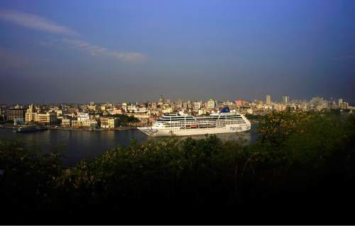 FILE - In this May 2, 2016 file photo, Carnival's Adonia cruise ship arrives from Miami in Havana, Cuba, the first step toward a future in which thousands of ships a year could cross the Florida Straits, long closed to most U.S.-Cuba traffic due to tensions that once brought the world to the brink of nuclear war. Around the world, television viewers watched prosperous-looking Americans greeted by trays of rum drinks and Afro-Cuban dancers in skimpy Cuban flag-patterned bathing suits. For many Cubans, it was a spectacle uniting the worst exotic stereotypes about their country with disrespect for a symbol of independence. (AP Photo/Ramon Espinosa, File)