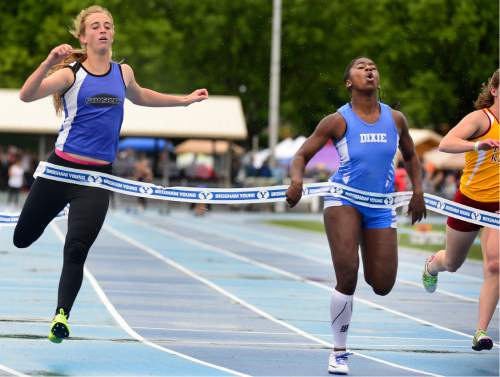 Scott Sommerdorf   |  The Salt Lake Tribune   Starlee Woodbury of Dixie, right, won the Girl's 3A 100M with a time of 14.64 at the second day of the state high school track & field meet at BYU, Saturday, May 21, 2016.
