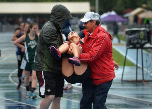 Scott Sommerdorf   |  The Salt Lake Tribune   A runner was carried off the track after passing out during the Girl's 3200M 1A race at the second day of the state high school track & field meet at BYU, Saturday, May 21, 2016.