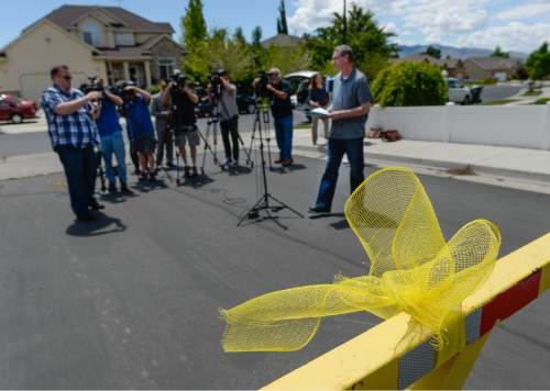 Francisco Kjolseth | The Salt Lake Tribune Yellow ribbons adorn the neighborhood as Richard Massey, a family spokesperson for missing UTA worker 63-year-old Kay Porter Ricks, whose body was found Tuesday in Wyoming, speaks with the media outside their neighborhood ward in Spanish Fork on Wednesday, May 18, 2016.