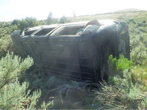 Courtesy  |  Utah Highway Patrol  A wrecked sports-utility vehicle sits on its side in the sagebrush along U.S. Highway 89 in Sanpete County on June 20, 2015. The crash killed 12-year-old Easton Taylor, of West Jordan.