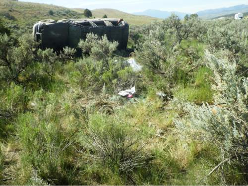 Courtesy of  Utah Highway Patrol A wrecked sports-utility vehicle sits on its side in the sagebrush along U.S. Highway 89 in Sanpete County in June 2015. The crash killed 12-year-old Easton Taylor, of West Jordan.