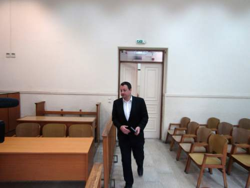 "In this photo taken on Wednesday, May 18, 2016 lawyer Thanos Koussoulos enters an empty courtroom in Athens. Greek lawyers have been on strike for four months against austerity measures that impose heavy taxes on self-employed professionals. Greek lawyers have been on strike for four months against austerity measures that impose heavy taxes on self-employed professionals. Prime minister Alexis Tsipras won a vote in parliament early Monday May 23, 2016, that will heap more taxes on a dwindling number of Greeks able to pay them. Whereas previous protests against austerity cuts drew violent street demonstrations featuring hooded youths throwing firebombs, this time it's suited middle classes professionals revolting in what's been dubbed the ""necktie movement"". (AP Photo/Derek Gatopoulos)"