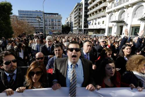 "FILE - In this Thursday, Jan. 14, 2016, file photo, lawyers shout slogans during a rally organized by Greek Bar Associations in Athens. Greek lawyers have been on strike for four months against austerity measures that impose heavy taxes on self-employed professionals. Greek lawyers have been on strike for four months against austerity measures that impose heavy taxes on self-employed professionals. Prime minister Alexis Tsipras won a vote in parliament early Monday May 23, 2016, that will heap more taxes on a dwindling number of Greeks able to pay them. Whereas previous protests against austerity cuts drew violent street demonstrations featuring hooded youths throwing firebombs, this time it's suited middle classes professionals revolting in what's been dubbed the ""necktie movement"". (AP Photo/Thanassis Stavrakis, File)"