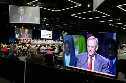 Methodist Council of Bishops President Bishop Bruce Ough is visible on multiple screens as he leads the room in prayer in Portland, Ore., Wednesday, May 18, 2016. The United Methodist Church, the nation's largest mainline Protestant denomination, is holding its once-every-four-years meeting here. It is facing a bitter fight over whether they should lift the church ban on same-sex marriage. (AP Photo/Don Ryan)