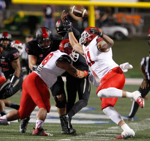 Utah defenders Viliseni Fauonuku and Kylie Fitts force a fumble against Fresno State quarterback Chason Virgil for a touchdown during the first half of an NCAA college football game in Fresno, Calif., Saturday, Sept. 19, 2015. (AP Photo/Gary Kazanjian)