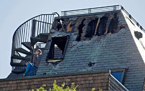 Lennie Mahler  |  The Salt Lake Tribune  People survey damage after a suspicious overnight house fire near the Capitol building took the life of John Williams, 72, a partner in Gastronomy, Inc., which owns restaurants in Salt Lake City.