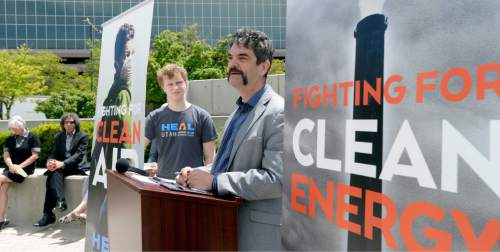 Al Hartmann  photo HEAL Utah Director Matt Pacenza hosted a press conference and small protest before the first session of the Governor's Energy Summit at the Salt Palace Tuesday May 24. HEAL wants the governor to restart its Clean Power Plan development and is upset that the energy summit includes only a few key voices with little representation of opposing views.