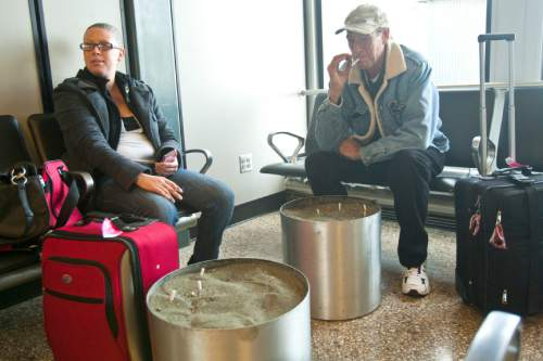 Chris Detrick  |   Tribune file photo Randall and Shannon Worsham, of California, smoke in the smoking lounge at the Salt Lake City International Airport Tuesday November 20, 2012.