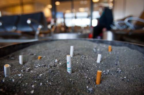 Chris Detrick  |   Tribune file photo Cigarette butts in the smoking lounge at the Salt Lake City International Airport Tuesday November 20, 2012.