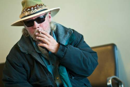 Chris Detrick  |   Tribune file photo Mark Wood, of Idaho Falls, smokes in the smoking lounge before his flight to Houston at the Salt Lake City International Airport Tuesday November 20, 2012.