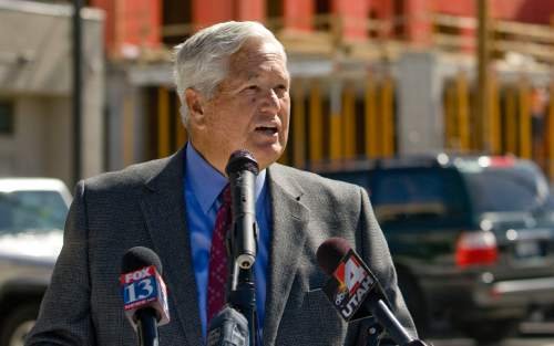 Tribune file photo Utah Transit Authority Board Chairman H. David Burton announces the agency has reversed course and will go back to opening its board committee meetings.