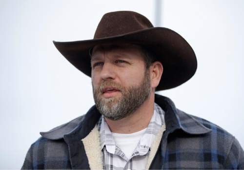 """Ammon Bundy, one of the sons of Nevada rancher Cliven Bundy, speaks with reporters during a news conference at Malheur National Wildlife Refuge headquarters Monday, Jan. 4, 2016, near Burns, Ore. The group calls itself Citizens for Constitutional Freedom and has sent a """"demand for redress"""" to local, state and federal officials. Armed protesters took over the Malheur National Wildlife Refuge on Saturday after participating in a peaceful rally over the prison sentences of local ranchers Dwight and Steven Hammond. (AP Photo/Rick Bowmer)"""